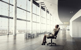 Businesswoman having rest in office Stock Photography