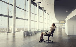 Businesswoman having rest in office Royalty Free Stock Images