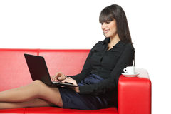 Businesswoman having rest on the sofa with laptop Stock Photography