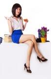 Businesswoman having tea break sitting on table Royalty Free Stock Photo