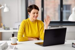 Businesswoman having video call at office royalty free stock images