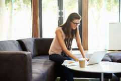 Businesswoman Having Working Lunch In Office Royalty Free Stock Photos