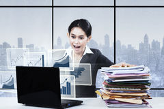Businesswoman having workload in the office Stock Photography