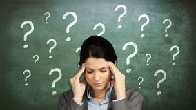 Businesswoman with head ache. Against question marks stock footage