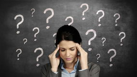 Businesswoman with head ache. Against question marks stock video footage