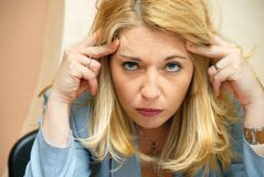 Businesswoman headache Stock Photo