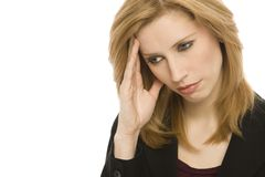 Businesswoman with headache. A businesswoman holds her hand to her head in pain Royalty Free Stock Image