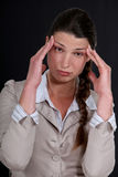 Businesswoman with a headache. Royalty Free Stock Images