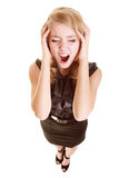 Businesswoman with headache head pain screaming. Businesswoman with head pain screaming. Frustrated blonde girl with headache shouting isolated on white. Stress Stock Image