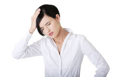 Businesswoman with a headache holding head Stock Images