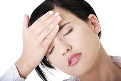 Businesswoman with a headache holding head Stock Photography