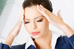 Businesswoman with a headache Stock Photography