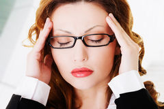 Businesswoman with a headache Royalty Free Stock Image