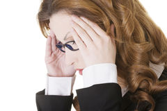 Businesswoman with a headache holding head Royalty Free Stock Photography