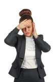 Businesswoman with a headache holding head Stock Image