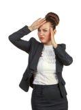 Businesswoman with a headache holding head Stock Photos