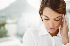 Businesswoman with headache at office Stock Image