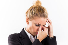 Businesswoman with a headache Stock Images