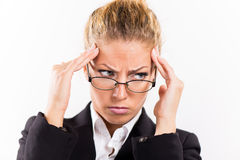 Businesswoman with a headache Stock Photo