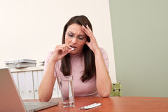 Businesswoman with headache take pill Royalty Free Stock Photography