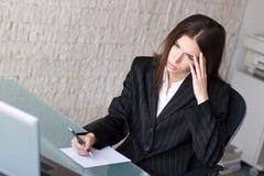 Businesswoman headache. Young adult businesswoman with headache, business failure Stock Photos