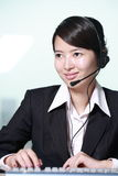 Businesswoman with headset Stock Images