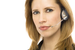 Businesswoman with headset. Businesswoman in a suit uses a modern headset Royalty Free Stock Images