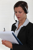 Businesswoman with a headset on. Royalty Free Stock Photos
