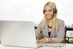 Businesswoman and headset Stock Images