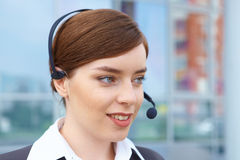Businesswoman with headset. Royalty Free Stock Photo