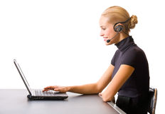Businesswoman with headset. Businesswoman or secretary with headset and laptop, isolated Stock Image