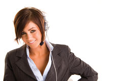 Businesswoman with headset. Studio portrait of a smiling young businesswoman wearing a telecommunications headset. Isolated on a white background royalty free stock photo