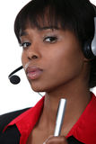Businesswoman with a headset on. Stock Photography