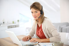 Businesswoman with headset on Royalty Free Stock Photography