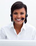 Businesswoman with headset on in a call center Stock Photos