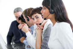 Businesswoman with headset on in a call center Royalty Free Stock Images