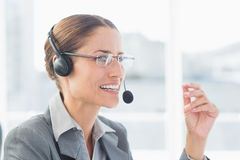 Businesswoman with headset in call centre Stock Image