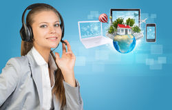 Businesswoman in headset, Globe, computers Royalty Free Stock Image