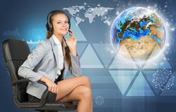 Businesswoman in headset, Globe and networks Royalty Free Stock Photo