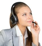Businesswoman in headset, with her fingers on Stock Image