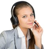 Businesswoman in headset, with her fingers on Stock Photography