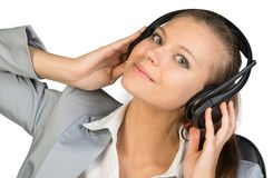 Businesswoman in headset with her hands on Stock Photos