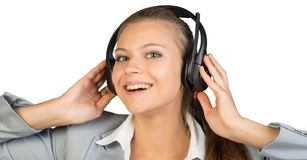 Businesswoman in headset with her hands on Stock Image