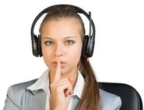 Businesswoman in headset holding finger to her Royalty Free Stock Photos