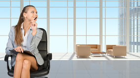 Businesswoman in headset, interior with Royalty Free Stock Photo