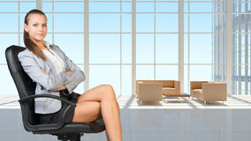 Businesswoman in headset, interior with Royalty Free Stock Photos