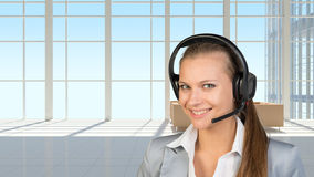 Businesswoman in headset, interior with Royalty Free Stock Images