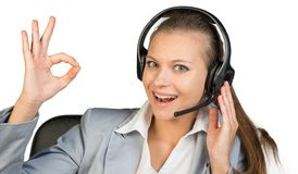 Businesswoman in headset making okay gesture Royalty Free Stock Photo