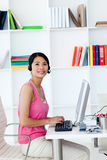 Businesswoman with headset on in the office Stock Photography