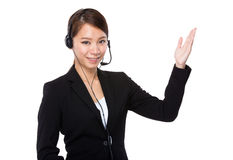 Businesswoman with headset and open hand palm Royalty Free Stock Images